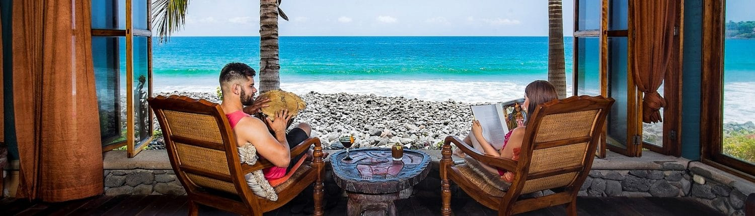 Real Estate in Riviera Nayarit Mexico - image of young couple looking out window at the ocean