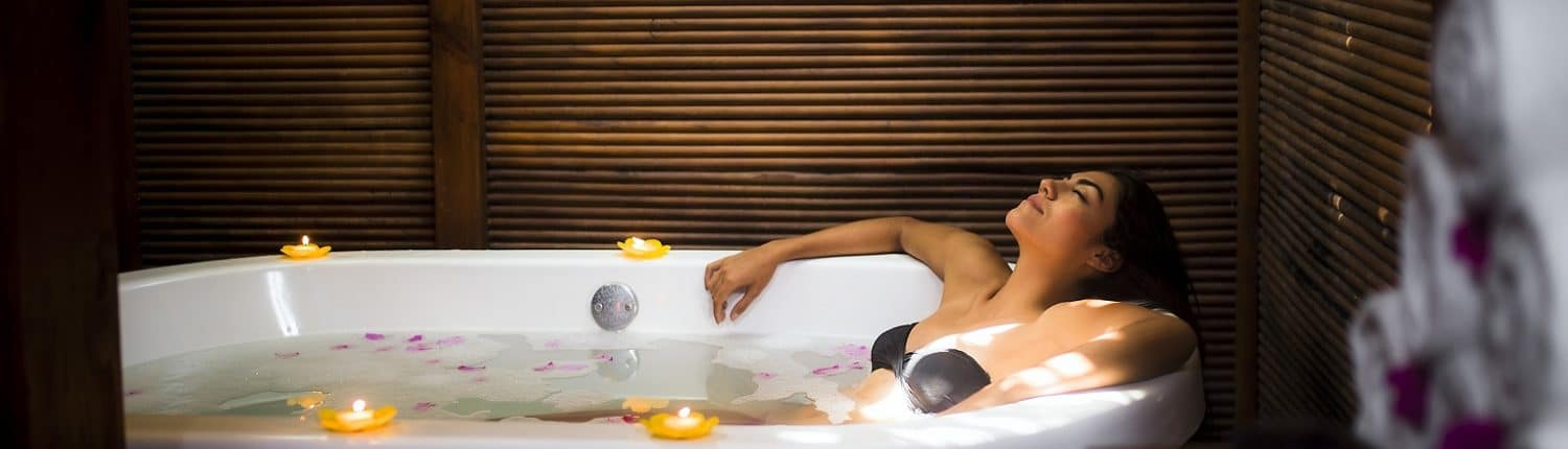 Woman soaking in Spa in Riviera Nayarit Mexico
