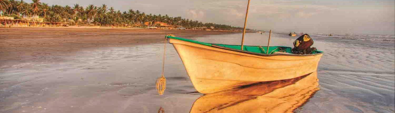 Small boat on the beach in Novillero Riviera Nayarit Mexico