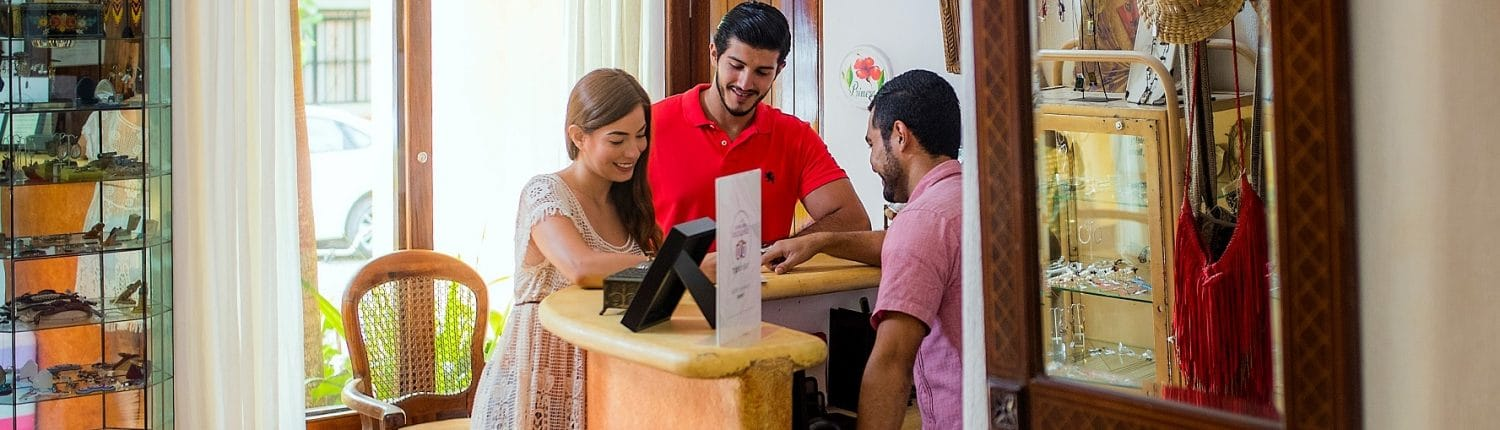 Riviera Nayarit Mexico Requirements & Legal Documents - image of couple at a service desk
