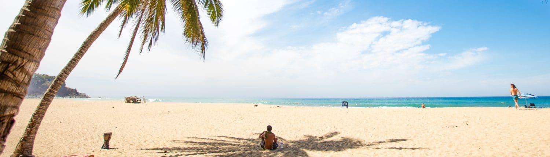 Wide sandy beach in San Pancho Riviera Nayarit Mexico