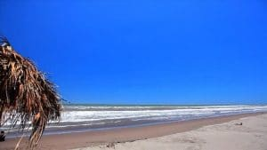 White sandy beach and deep blue sky of Sesteo Riviera Nayarit