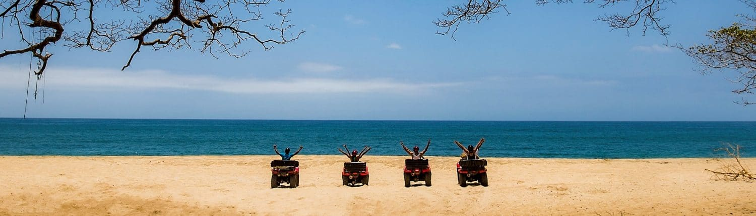 ATV adventures in Riviera Nayarit Mexico - 4 people on the beach with ATVs