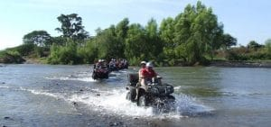Group on ATVs cross a river in Riviera Nayarit MX