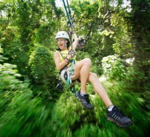 Young girl enjoying Canopy Zip Lining in Riviera Nayarit MX