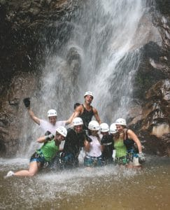 Rapelling group enjoying the pool at the base of a waterfall in Riviera Nayarit