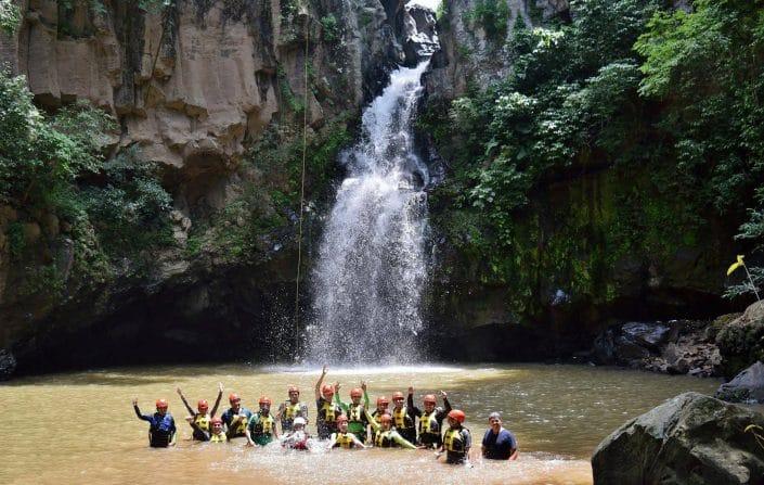 Rappelling in Riviera Nayarit Mexico - image of rappelling group in pool below waterfalls