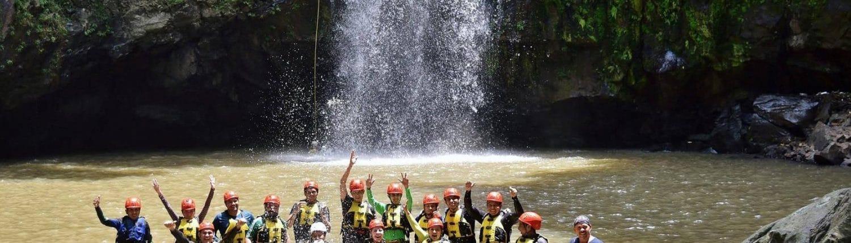 Rappelling group in pool below waterfalls in Riviera Nayarit Mexico