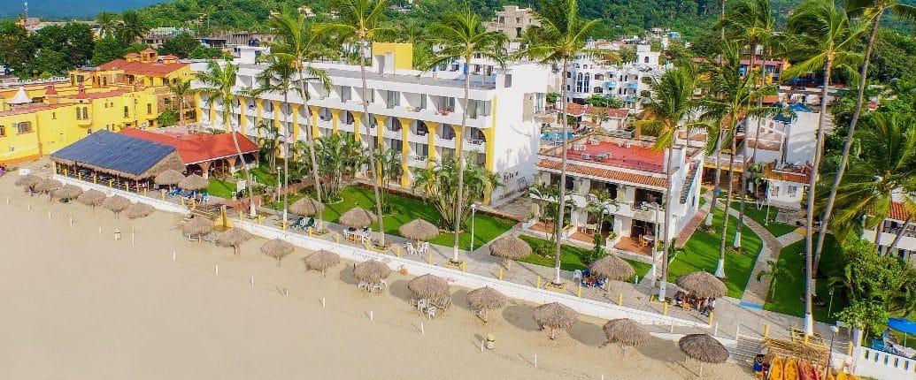 Aerial view of beach and Costa Alegre hotel in Rincon de Guayabitos Riviera Nayarit Mexico
