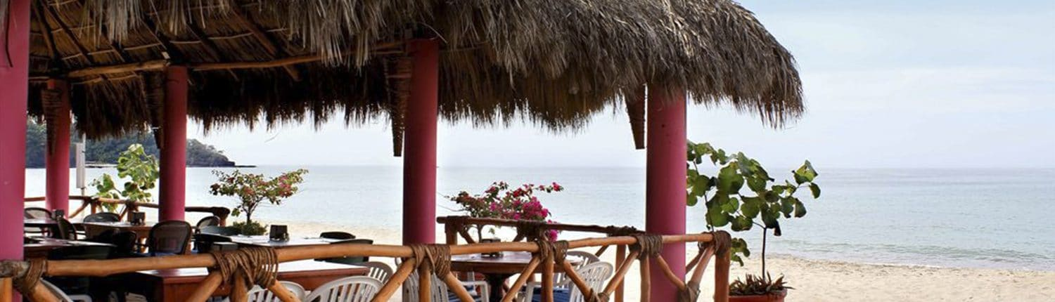 Palapa covered beach restaurant at Decameron Los Cocos hotel in Guayabitos Riviera Nayarit Mexico