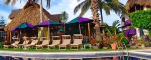 Poolside lawn chairs at Villa Bella Hotel in La Cruz de Huanacaxtle Riviera Nayarit Mexico