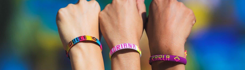 3 arms showing wrist bands- Acerca-de-Nosotros Riviera Nayarit Visitors and Conventions Bureau