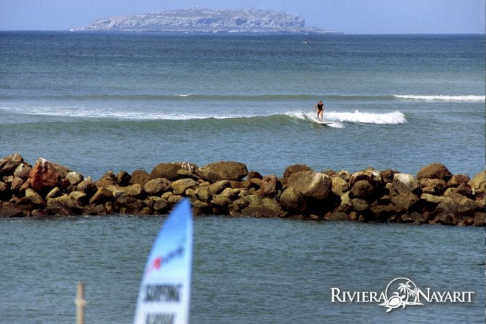 Surfer riding the wave in Riviera Nayarit Mexico