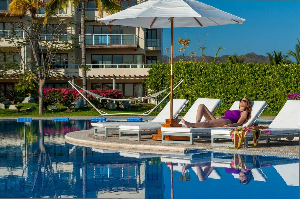 Sun tanning by the pool at B Nayar Hotel in La Cruz de Huanacaxtle Riviera Nayarit MX