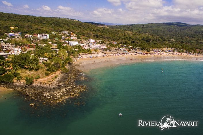 Aerial view of beach and town of Chacala in Riviera Nayarit Mexico