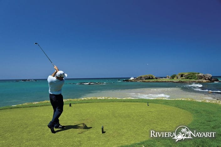 Golfing to island green at Punta Mita Golf Course in Riviera Nayarit Mexico
