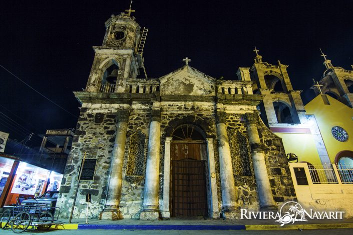 Colonial church facade lit up at night in San Blas Riviera Nayarit Mexico