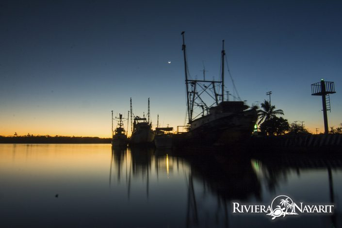 Moored fishing boats at dusk in San Blas Riviera Nayarit Mexico