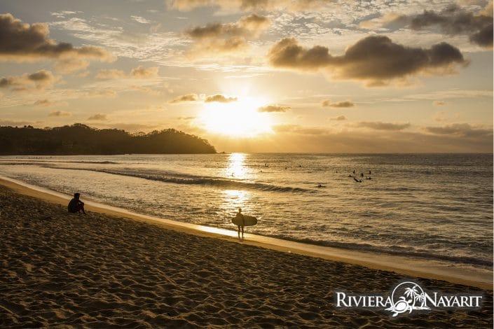 Surfing at sunset in Sayulita Riviera Nayarit Mexico