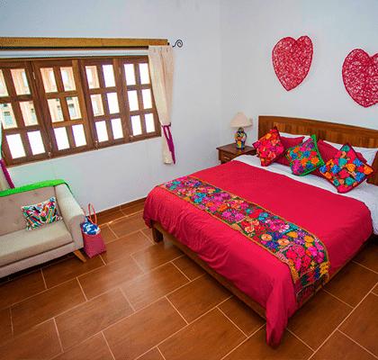 Typical bedroom in Hotel Refugio del Mar suites