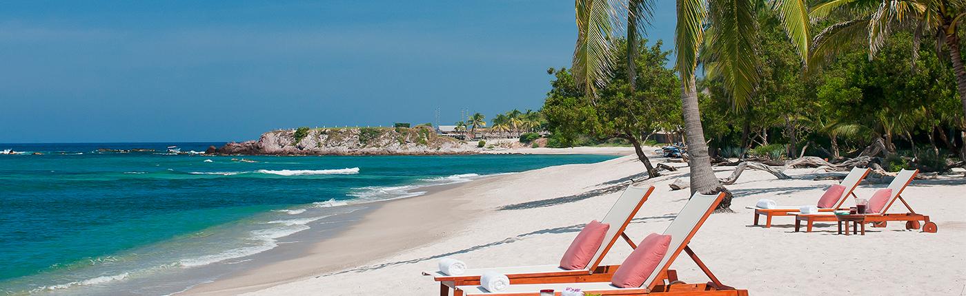 Empty beach chairs of white sandy beach in Nayarit