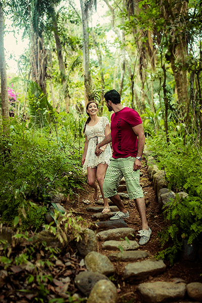 Young couple holding hands while enjoying a rainforest walk