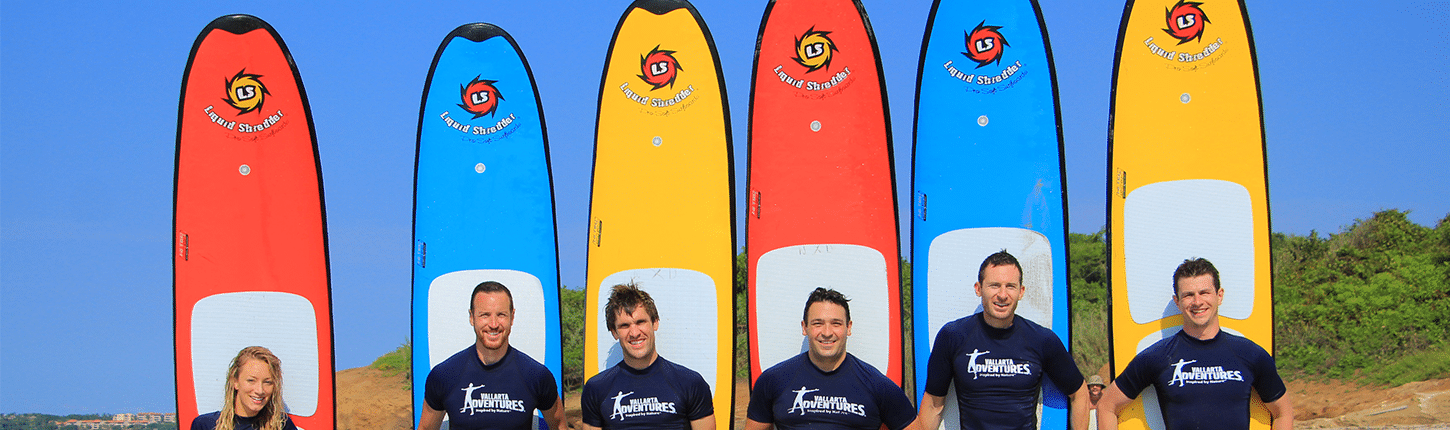 Six instructors with their paddle boards in Riviera Nayarit