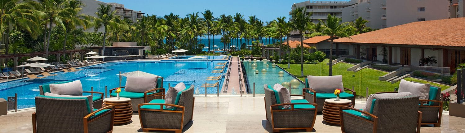 Pool and deck with chairs at Reflect Hotel in Riviera Nayarit